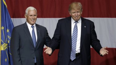 Indiana Governor Mike Pence joined Donald Trump as confirmed Republican president and vice-president nominees.