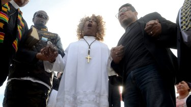 Dr Jeannetta Million of Victorious Believers Church leads a group of local pastors in a brief prayer vigil in San Bernardino.