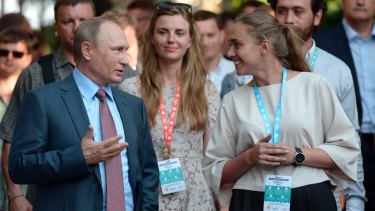 Russian President Vladimir Putin, left, visits a youth educational forum in Crimea earlier this month.