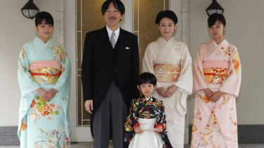 "Japan's Prince Hisahito, wearing a traditional ceremonial attire, with his parents, Prince Akishino, Princess Kiko, his sisters Princess Mako, left, and Princess Kako, right, after attending ""Chakko-no-gi"" ceremony to celebrate his passage from infancy to childhood in 2011."