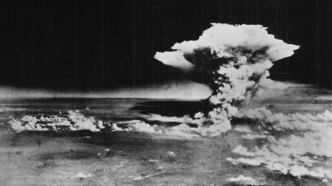 In this handout picture released by the US Army, the plume of smoke from a mushroom cloud  billow, about one hour after the nuclear bomb was detonated above Hiroshima, Japan on August 6, 1945.