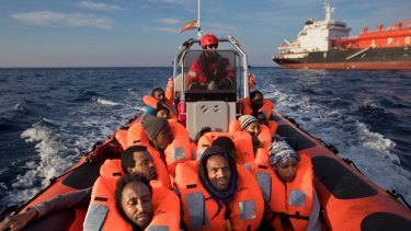 Eritrean migrants sit on a Proactiva Open Arms rescue boat in the Mediterranean sea, about 56 miles north of Sabratha, Libya, Thursday, April 6, 2017.