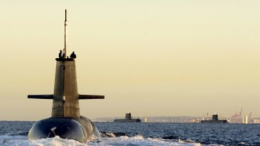 The government has stopped short of promising to build the submarine fleet at home.