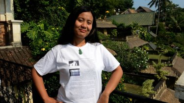 Silenced: Indonesian novelist Eliza Vitri Handayani wears her work in Ubud after a session launching her latest work was cancelled.