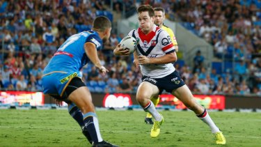 Stepping up: Luke Keary is full of running against the Titans. Mitchell Pearce says he is enjoying teaming up with his new halves partner.