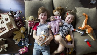 Spencer Howley, 7, and his sister Saffron, 4, play with their toys in the family home in East St Kilda.
