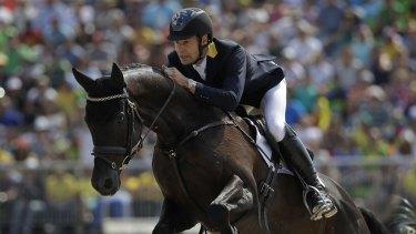 Chris Burton rides Santano II to clinch a team bronze medal for Australia in the equestrian