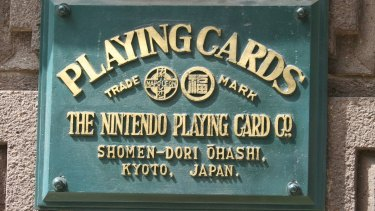 The plaque at the original headquarters of Nintendo Playing Card Co., renamed Nintendo Co. by Hiroshi Yamauchi in 1963.