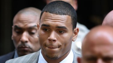 Convicted ... Chris Brown, then 19, leaves court in 2009 after facing assault charges against former girlfriend Rihanna.