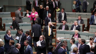 Prime Minister Malcolm Turnbull enters the House after his government lost a division 69-61.