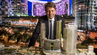 Echo Entertainment chief executive Matthew Bekier with a model of the new Brisbane waterfront casino.