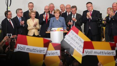 Germany's Chancellor Angela Merkel addresses her supporters and claims victory.