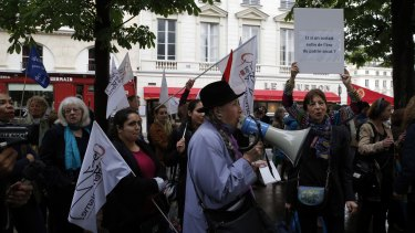 Feminist groups gather during a protest on Wednesday to demand an end to widespread sexism in French politics.