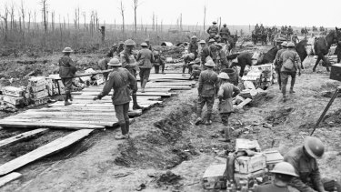 The 2nd Australian Pioneer Battalion making a wagon track from planks of wood at Chateau Wood during  the Battle of Passchendaele.
