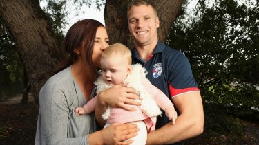 Western Bulldogs footballer Jake Stringer with his partner Abby and their daughter Milla.