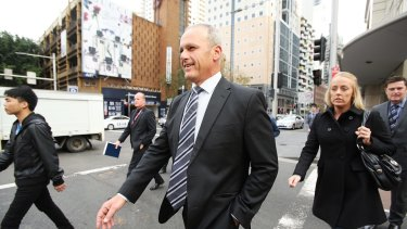 Angelo Memmolo (3rd from left) the officer incharge of the police investigation into the Martin Place siege leaves the John Maddison Tower where the Martin Place siege inquest is being held.