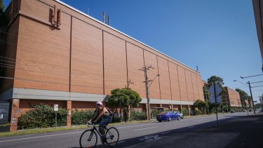 The 'Great Wall of Alphington' - the massive orange walls of the old paper mill - are being demolished for the project.