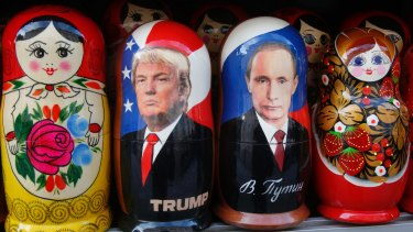 Traditional Russian wooden dolls depicting US President Donald Trump and Russian President Vladimir Putin.