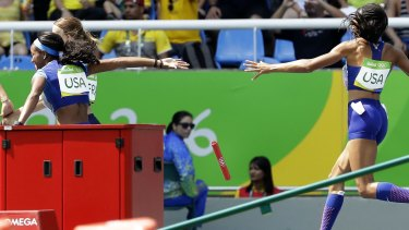Botched baton drop: English Gardner and Allyson Felix, right, from the United States drop the baton.