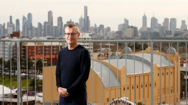 Great view: Resident Russell Jessop, who will give tours of Edgewater Towers apartment block next week, says the stunning views (from the roof, of Melbourne CBD in background, Palais Theatre in foreground) inspired him to move here.