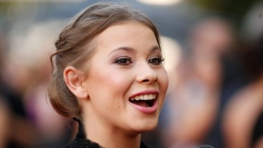 Bindi Irwin, wearing Alex Perry, arrives at the AACTA Awards in Sydney.