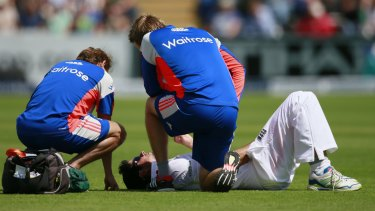 Ice pack please ... Alastair Cook receives medical attention after being hit by the ball in the groin.