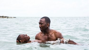 Alex Hibbert, foreground, and Mahershala Ali in Moonlight.