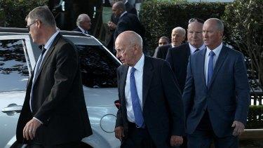 Rupert Murdoch leaves Catalina restaurant in Rose Bay under heavy guard.