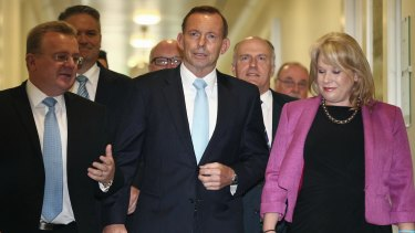 Prime Minister Tony Abbott departs the Liberal party room meeting.