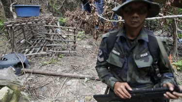 A cage is seen at an abandoned human trafficking camp in the jungle close the Thai border at Bukit Wang Burma in northern Malaysia in May.