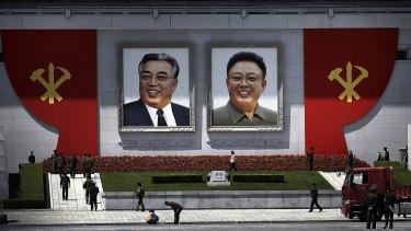 Portraits of the late North Korean leaders Kim Il-sung and Kim Jong-il in North Korea.