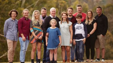 Ian Bell and wife Vicky (centre) with his children (from left to right): Byron, Blake, Shannon, Jason, Jarrad, William, Carissa and Devin, with Chloe and Trent in front.