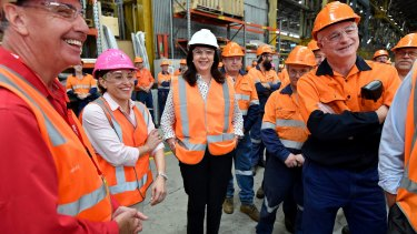 Queensland Premier Annastacia Palaszczuk, centre, on the campaign trail.