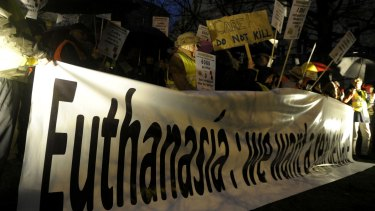 Protesters in Brussels oppose a law authorising euthanasia for children last year.