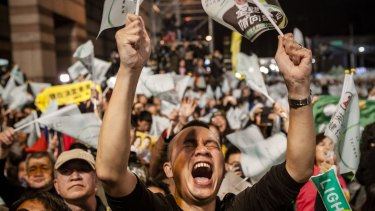 A supporter shouts as attend at DPP headquarters during Tsai Ing-wen's victory speech on January 16 in Taipei, Taiwan.