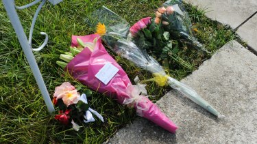 Floral tributes laid outside the Belle Avenue home.