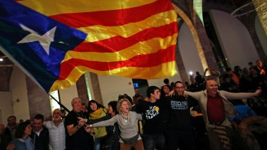 Catalan independence supporters wave a 'estelada' ( pro-independence Catalan flag ) in Barcelona.
