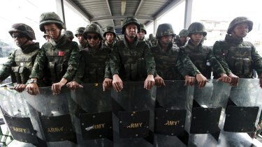 Thai soldiers guard an overpass to prevent an anti-coup demonstration in Bangkok in 2014.