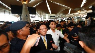 Expelled: North Korean ambassador to Malaysia Kang Chol, wearing a tie, at Kuala Lumpur International Airport in Sepang, Malaysia, on Monday.
