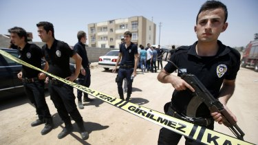Security outside a building after two police officers were found shot dead in their home in Ceylanpinar, a town near Turkey's border with Syria, on Wednesday.