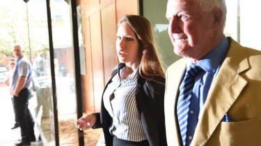 Sophia Tilley enters the Downing Centre Local Court with her father Barry Tilley.