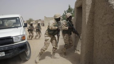 Chadian troops take part in training exercises in Chad.