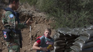 In this photo released by the United Nations Force in Cyprus on October 13, British actor Daniel Craig visits the minefields in the UN-controlled buffer zone on Cyprus, a deadly legacy of the conflict.