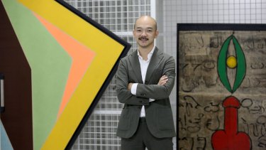 Aaron Seeto at Museum MACAN with Arahmaiani Feisal's 1994 painting Lingga-Yoni (right).