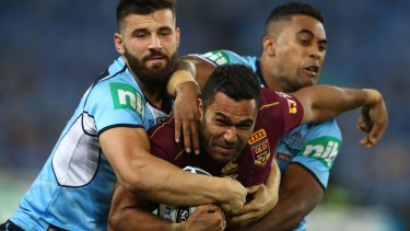 Controversial ruling: Justin O'Neill is tackled during Origin I.