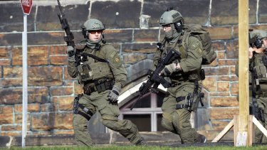 Members of a Royal Canadian Mounted Police intervention team respond to the shooting at the Parliament buildings in Ottawa.
