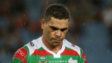 Tough night: Greg Inglis leaves the field after injury his knee in round one.