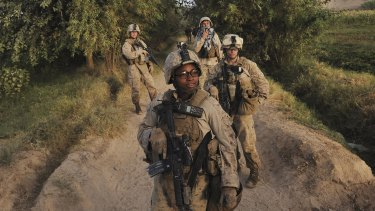 Corporal Christina Oliver, centre, and other female Marines on patrol in Afghanistan. The new Republican Party platform would bar women in the military from combat.