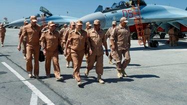Russian Defence Minister Sergei Shoigu, centre, visits Syria's Hmeimim air base last year.