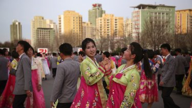 North Korean students participate in a mass dance event on Sunday to mark the late North Korean leader Kim Jong-Il's election as chairman of the National Defence Committee in 1993.